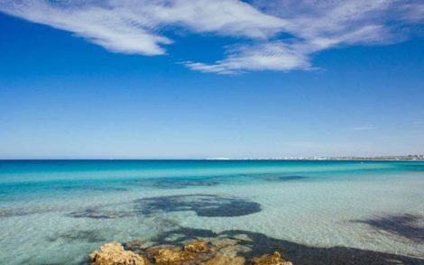 The crystal clear blue sea of Torre San Giovanni beach