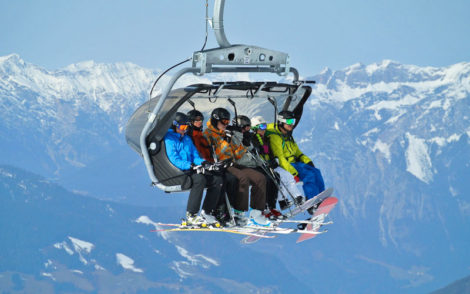 People on the ski lift in the Italian Alps